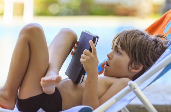Beach boy with tablet