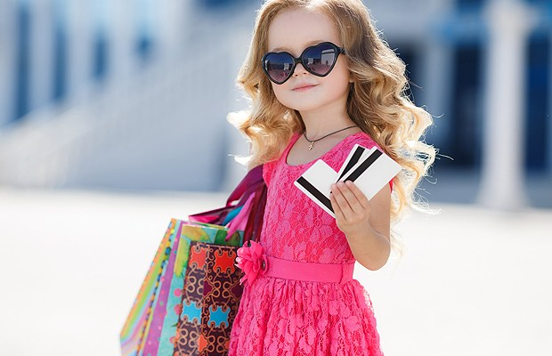 Girl with colorful bags and credit card